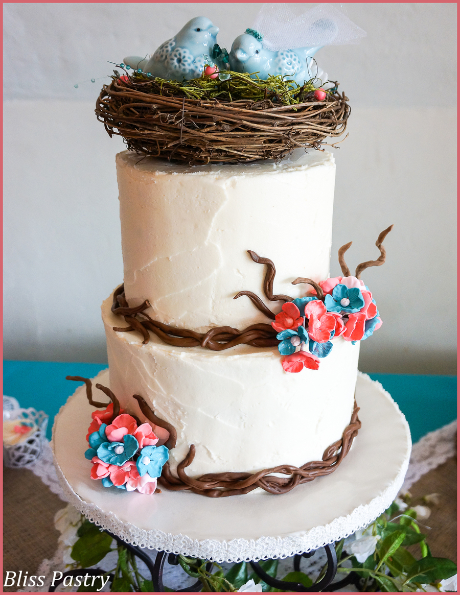 wedding cake with birds rustic buttercream iced wedding cake with fondant branches 26824