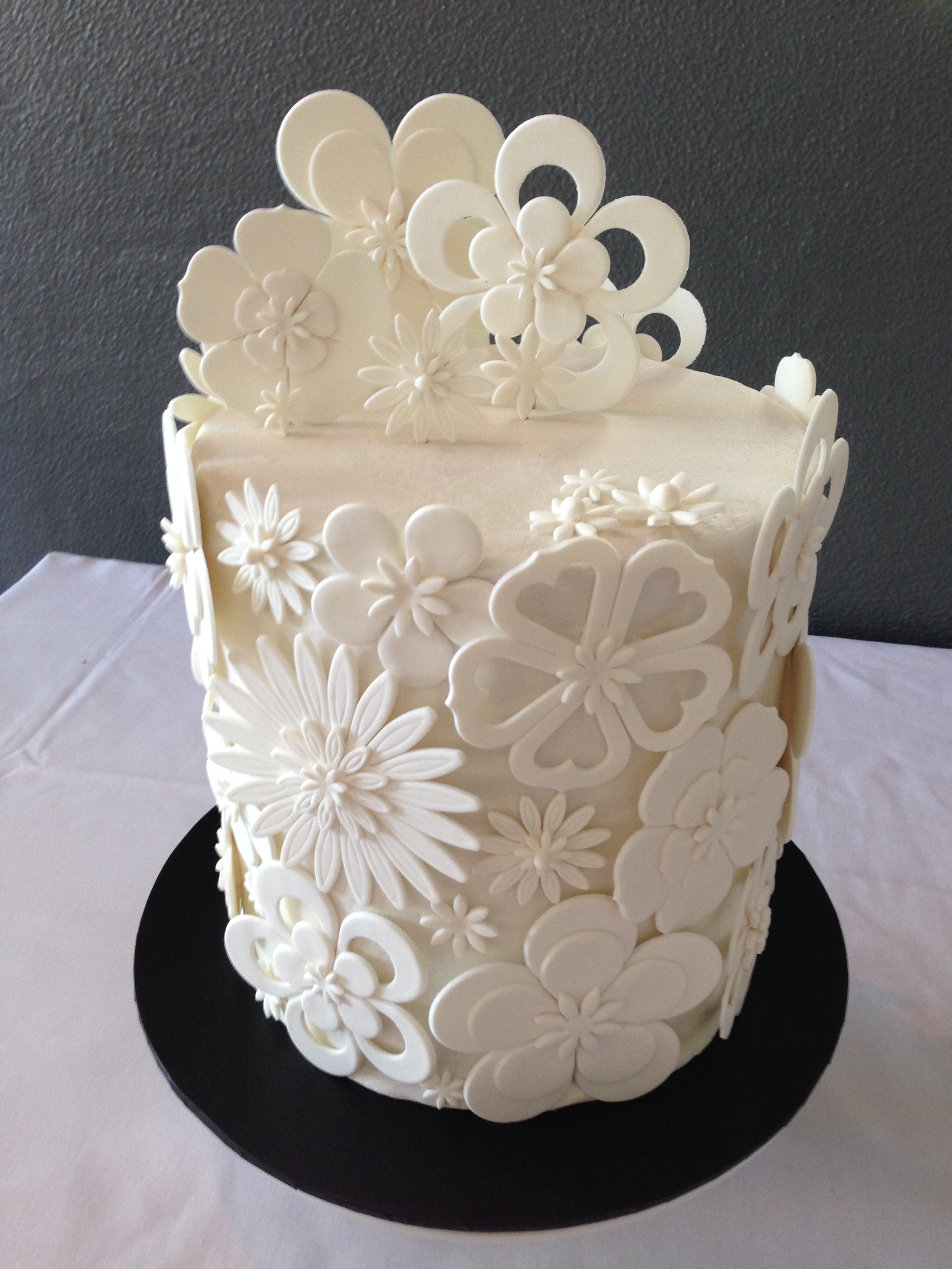 White Cut Out Flower Wedding Cake - CakeCentral.com