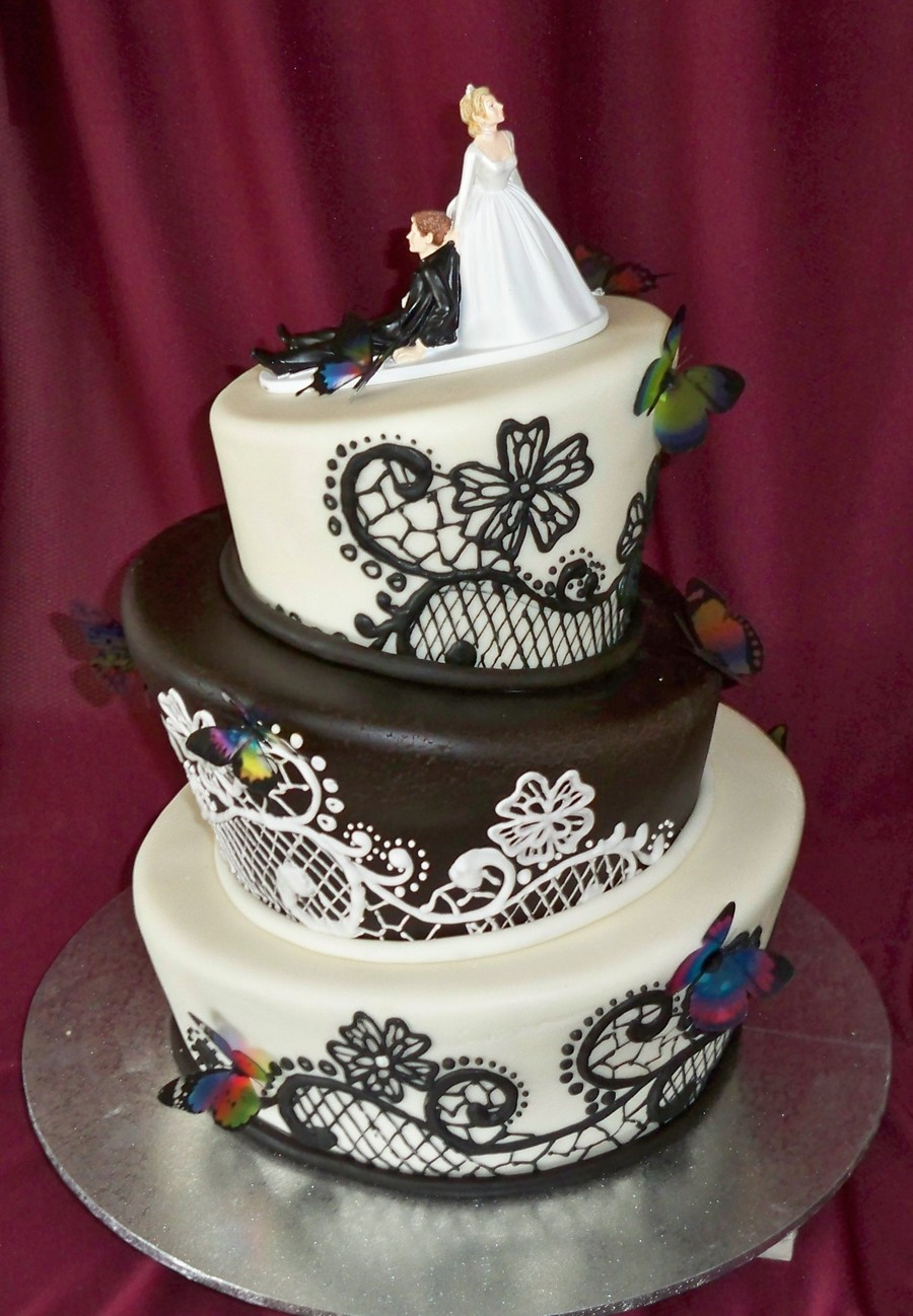 Black And White Topsy Turvy Wedding Cake With Butterflies ...
