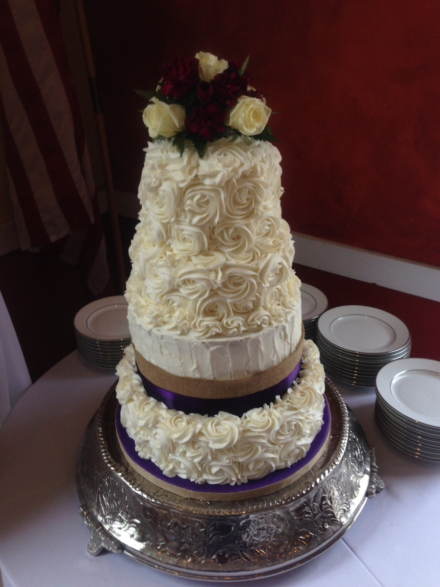 Four Tiered Wedding Cake Covered In Buttercream Roses Bottom Tier ...