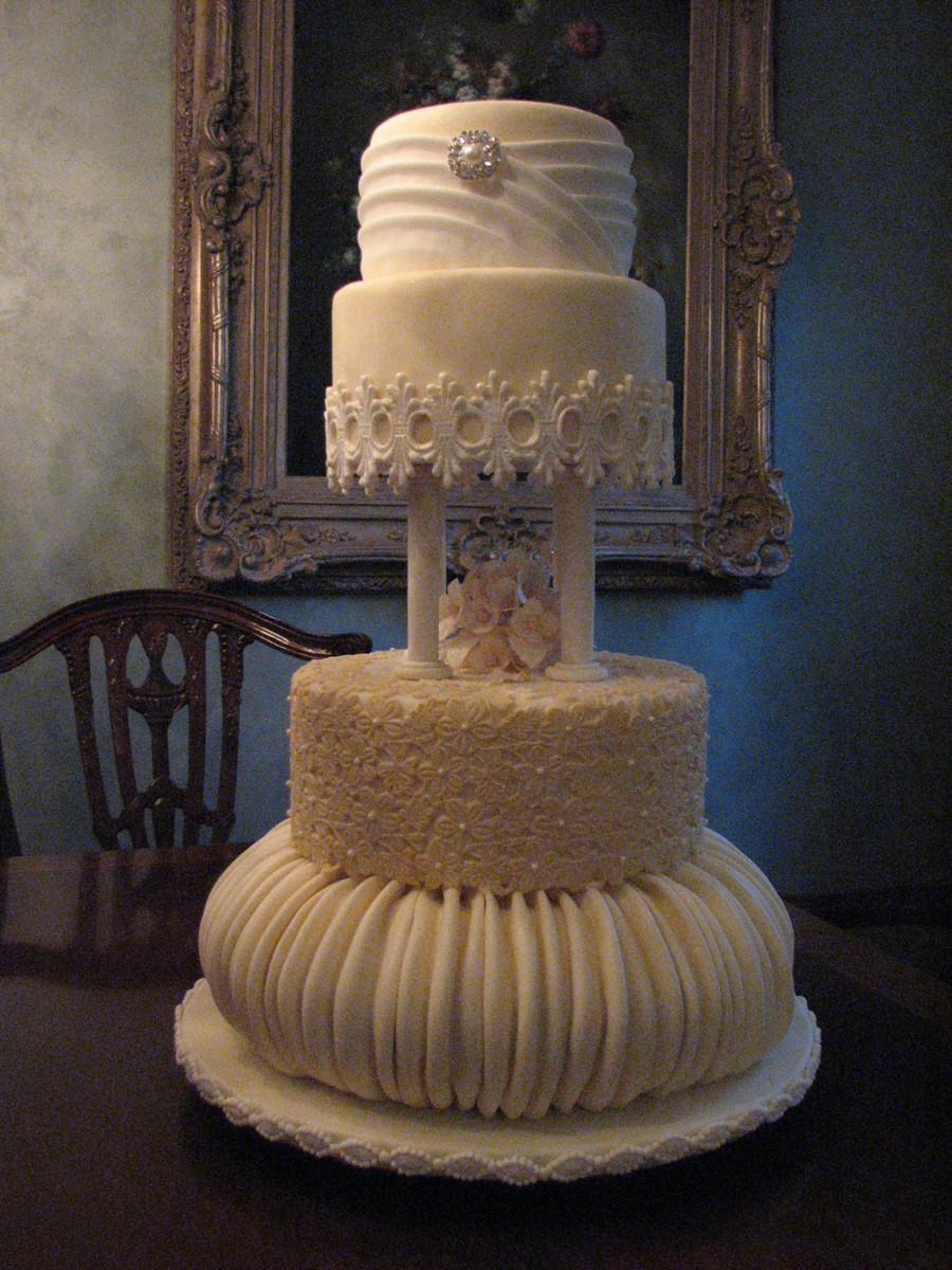 4 Tier Victorian Influence Wedding Cake In Ivory With Ruching And Lace Accents