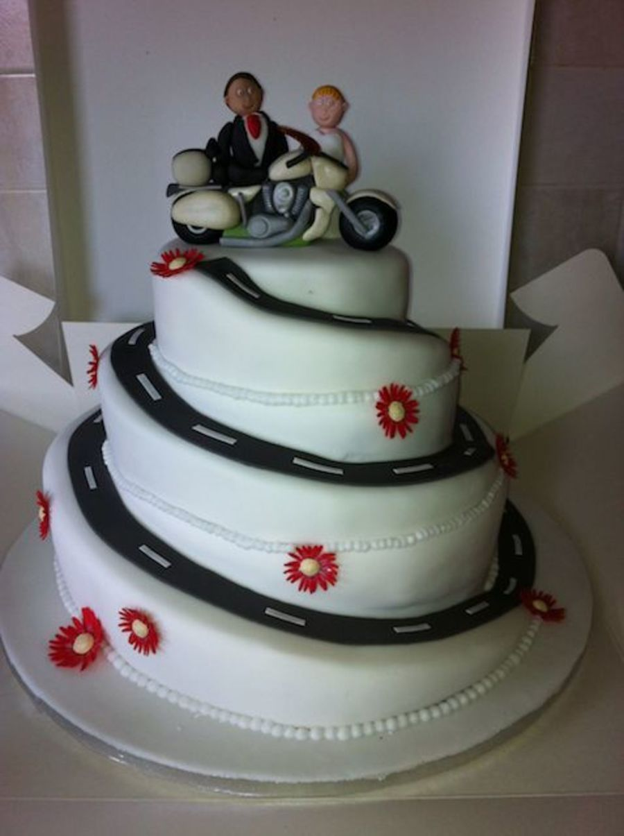 Spiral Wedding Cake With Gerberas And Motorbike on Cake Central