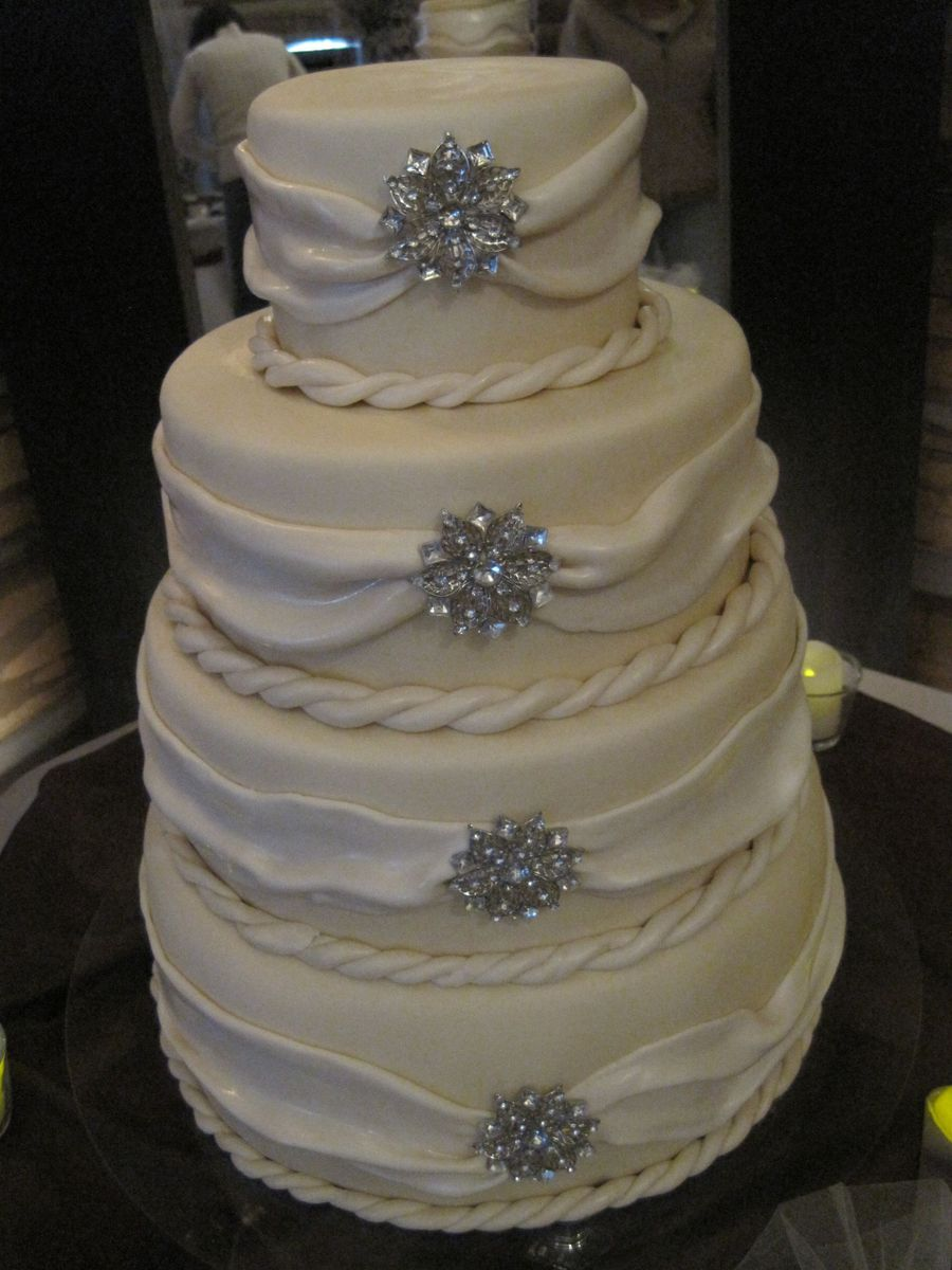 wedding cakes 4 tier round 4 tier white cake with draped swag and brooches 23754