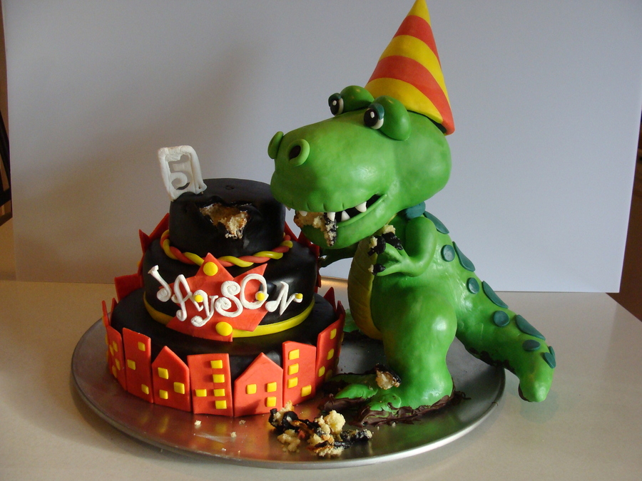 Dinosaur Cake Dinosaur Is Made Of Rkt Covered In Fondant Not Sure Who Originally Did This On Cc But My Grandson Was Thrilled And I Had  on Cake Central