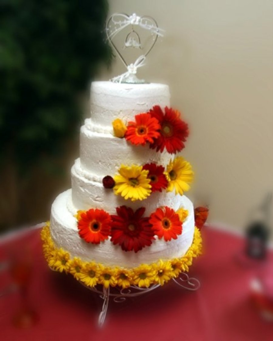 4 Tier Round With Gerber Daisies on Cake Central