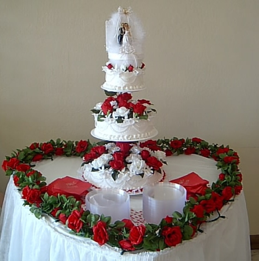 3 Tier Floating Round Cake With Red Roses White Cake With White