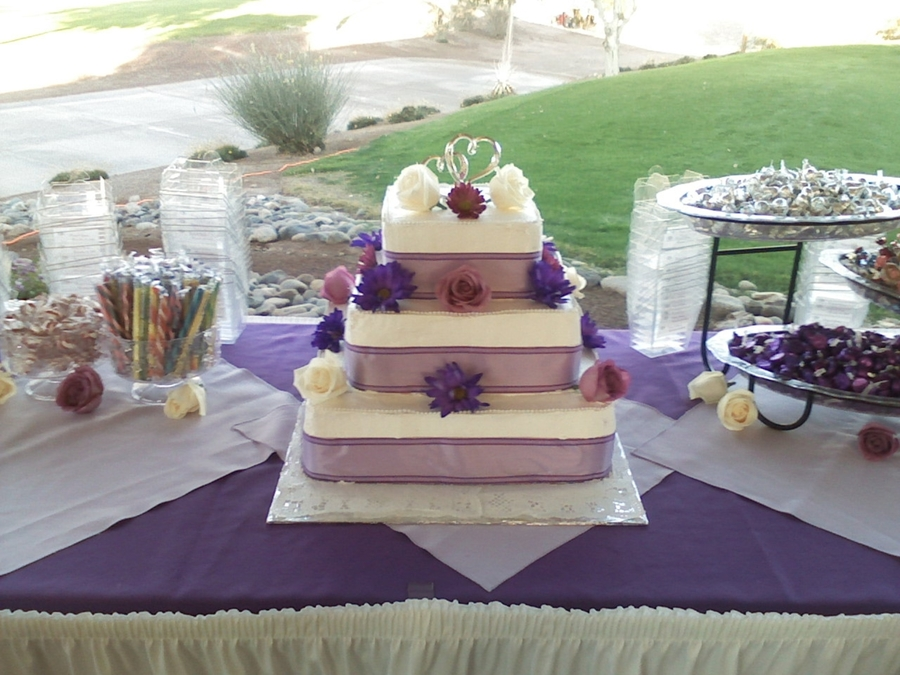 3 Tier Stacked Square Wedding Cake, White Cake With Non-Dairy Whipped Frosting, Purple Ribbon With Fresh Purple Roses And Fresh Daisys on Cake Central
