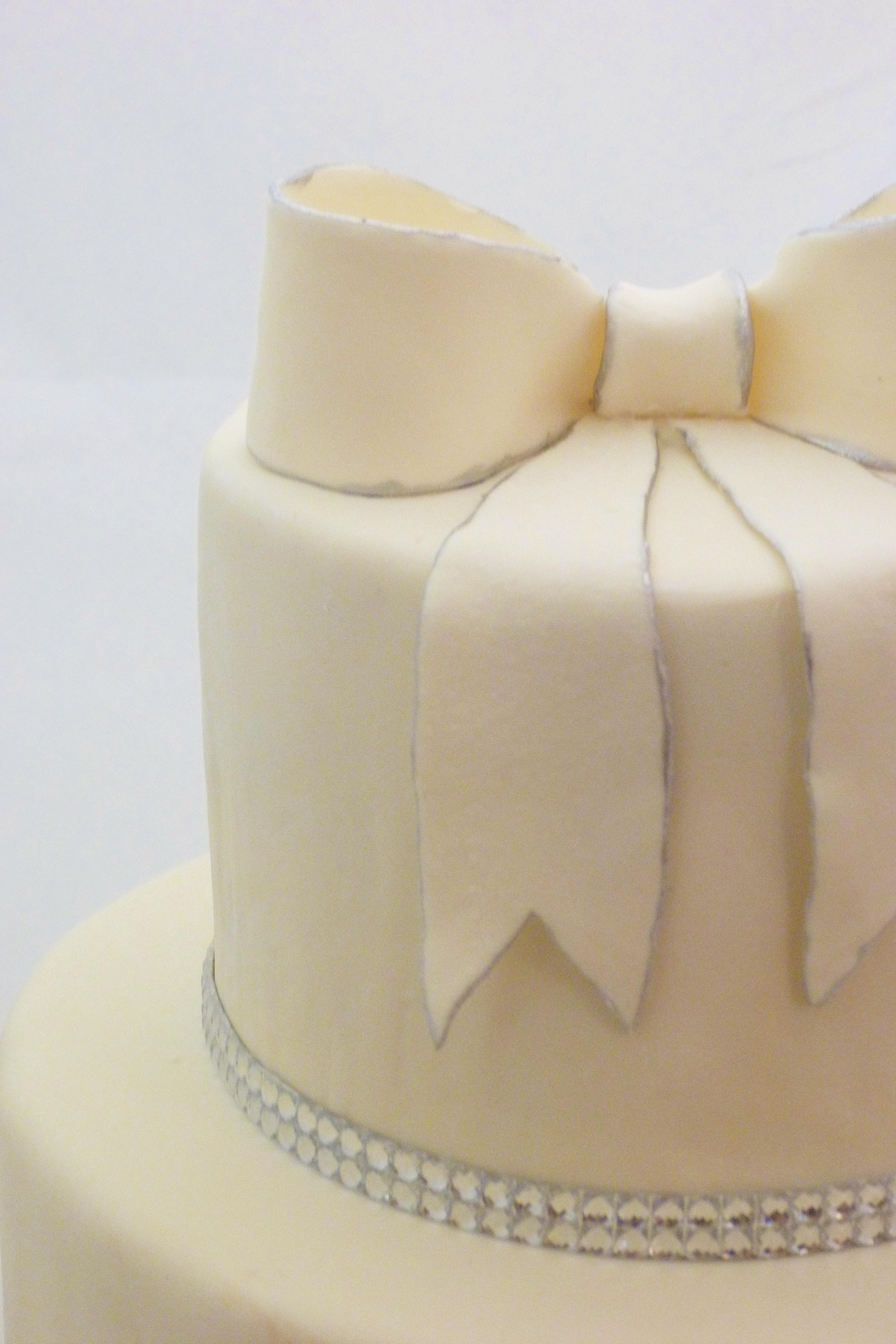 Elegant Round Wedding Cake With Fondant Silver Trim And Rhinestones