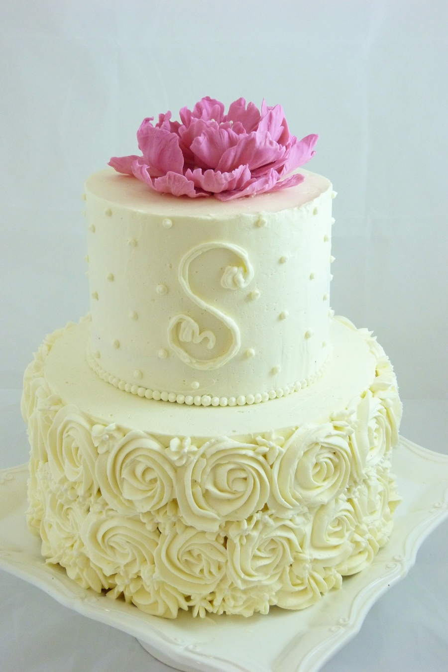 Buttercream decorated small wedding cake with piped roses dots and buttercream decorated small wedding cake with piped roses dots and a monogram handmade gum paste peony on top junglespirit Images