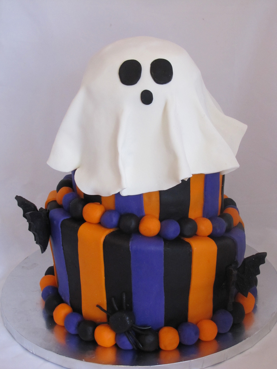 three tier fondant covered halloween cake with 3d bats and spiders for a kids halloween celebration