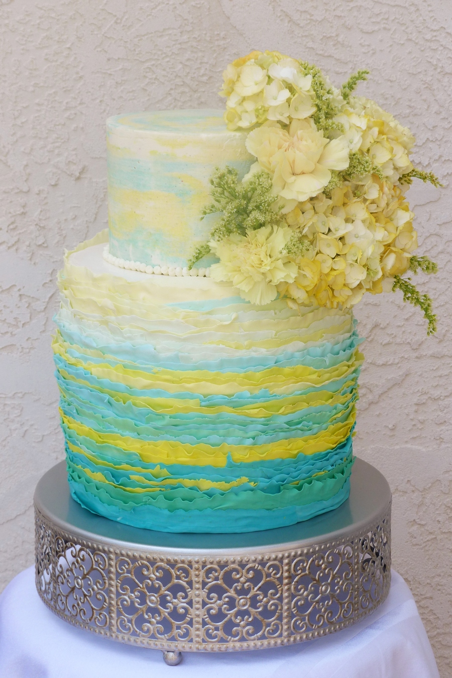 Ruffle And Buttercream Cake In Yellow And Teal With Fresh Flowers ...