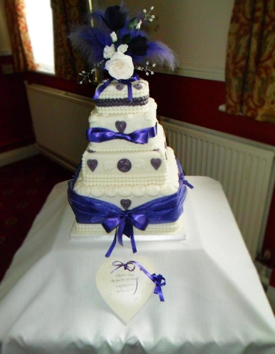 4 Tier Sponge Wedding Cake Chocolate Lemon And Orange Tiers Covered In White Sugar Paste With White And Purple Sugar Paste Decorations on Cake Central