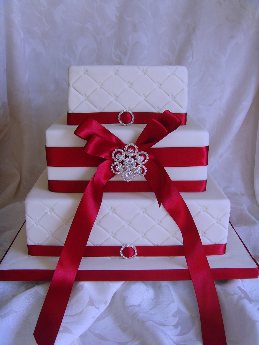 Ivory And Claret Stacked With Bow And Brooch on Cake Central