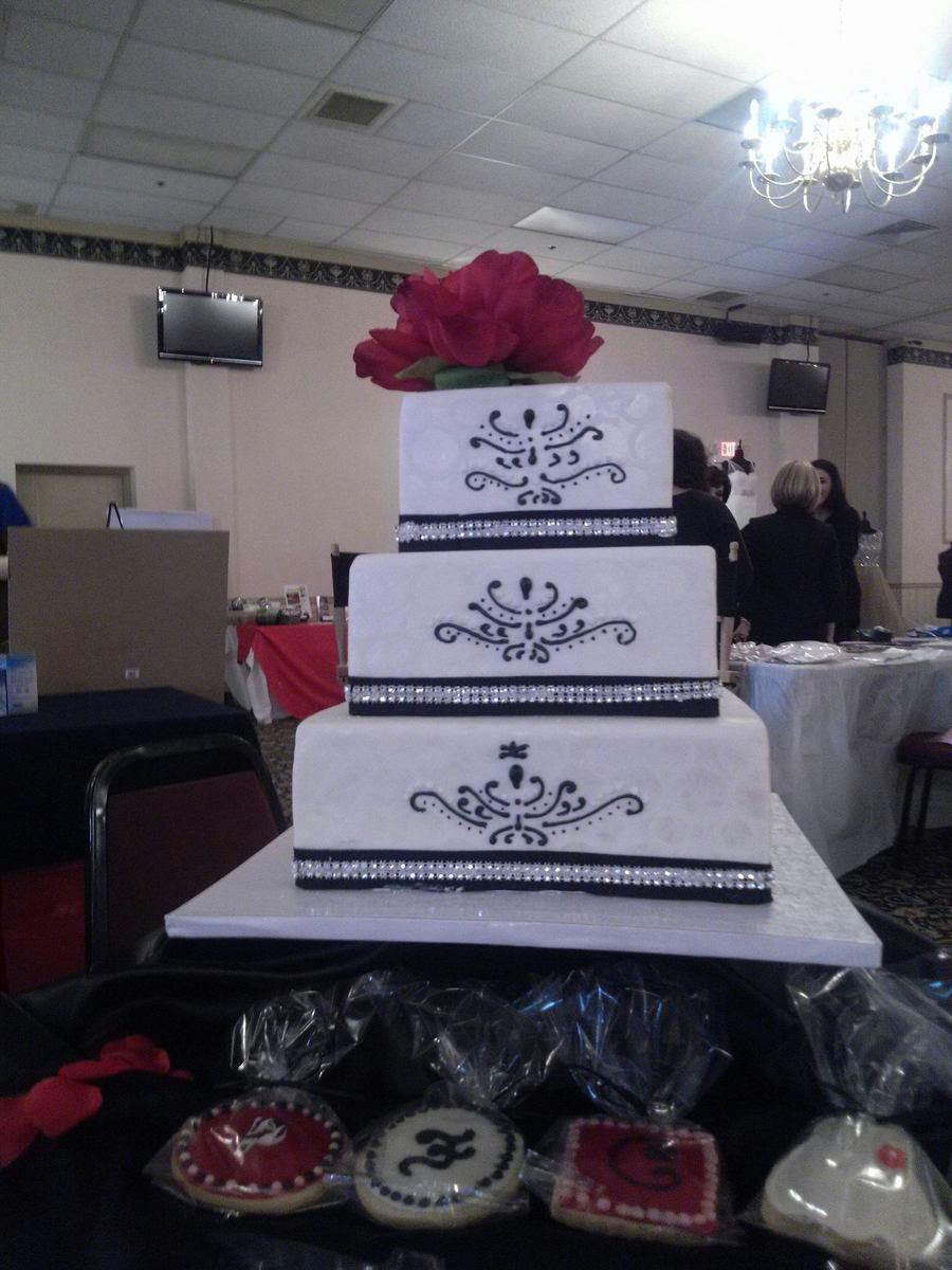 Fondant Covered Cake With Black And Rhinestone Ribbon And Hand Piping Done In Royal Icing Silk Flowers on Cake Central