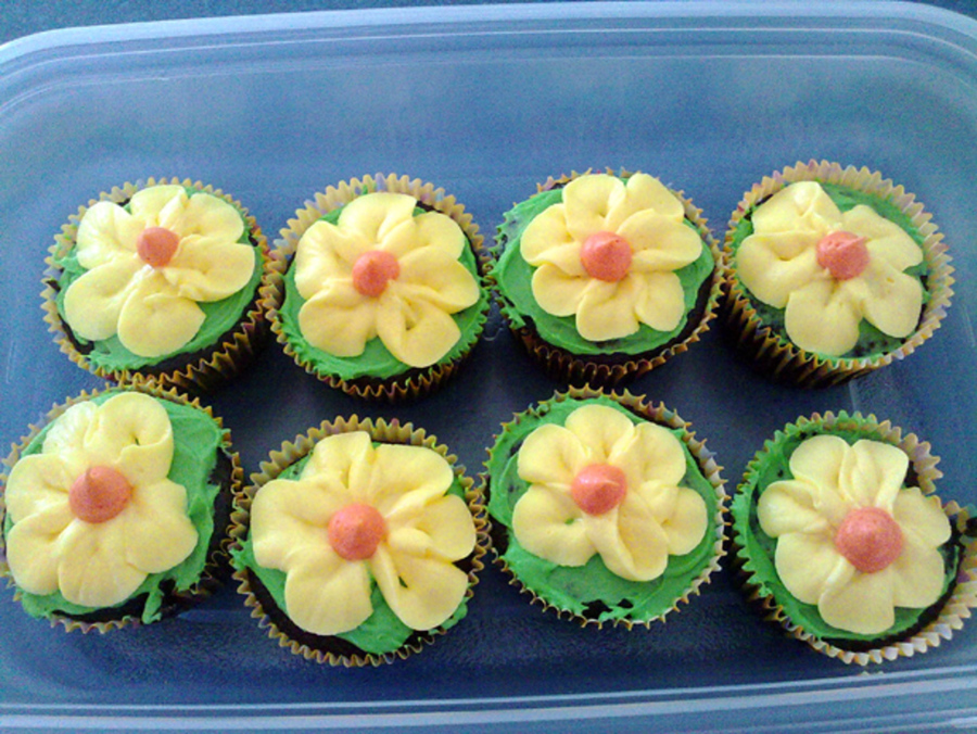 Yellow spring flower cupcakes cakecentral chocolate cupcakes with mint cream filling and a pretty yellow buttercream flower on top mightylinksfo