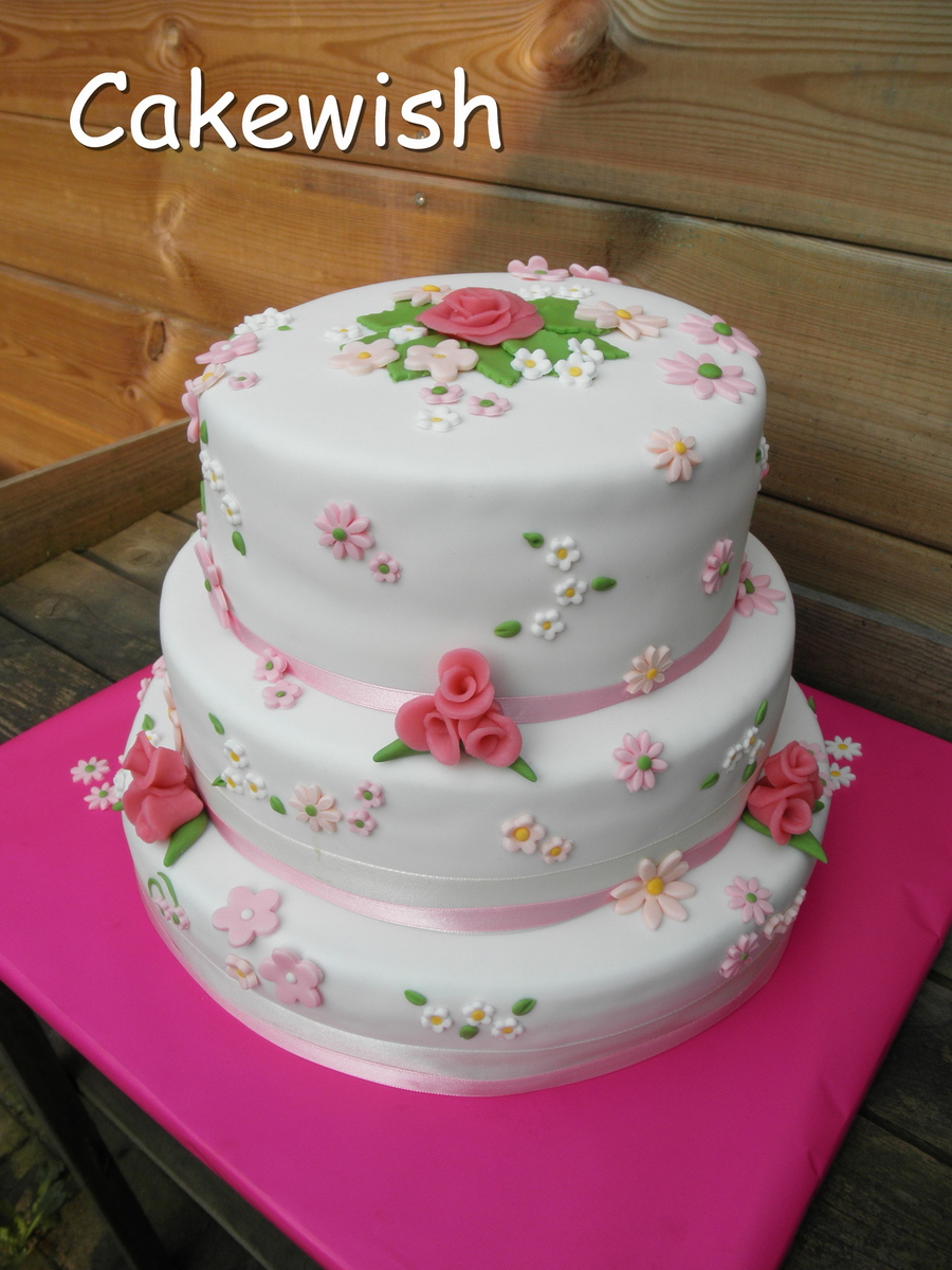 White Wedding Cake With Pastel Colored Flowers Cakecentral
