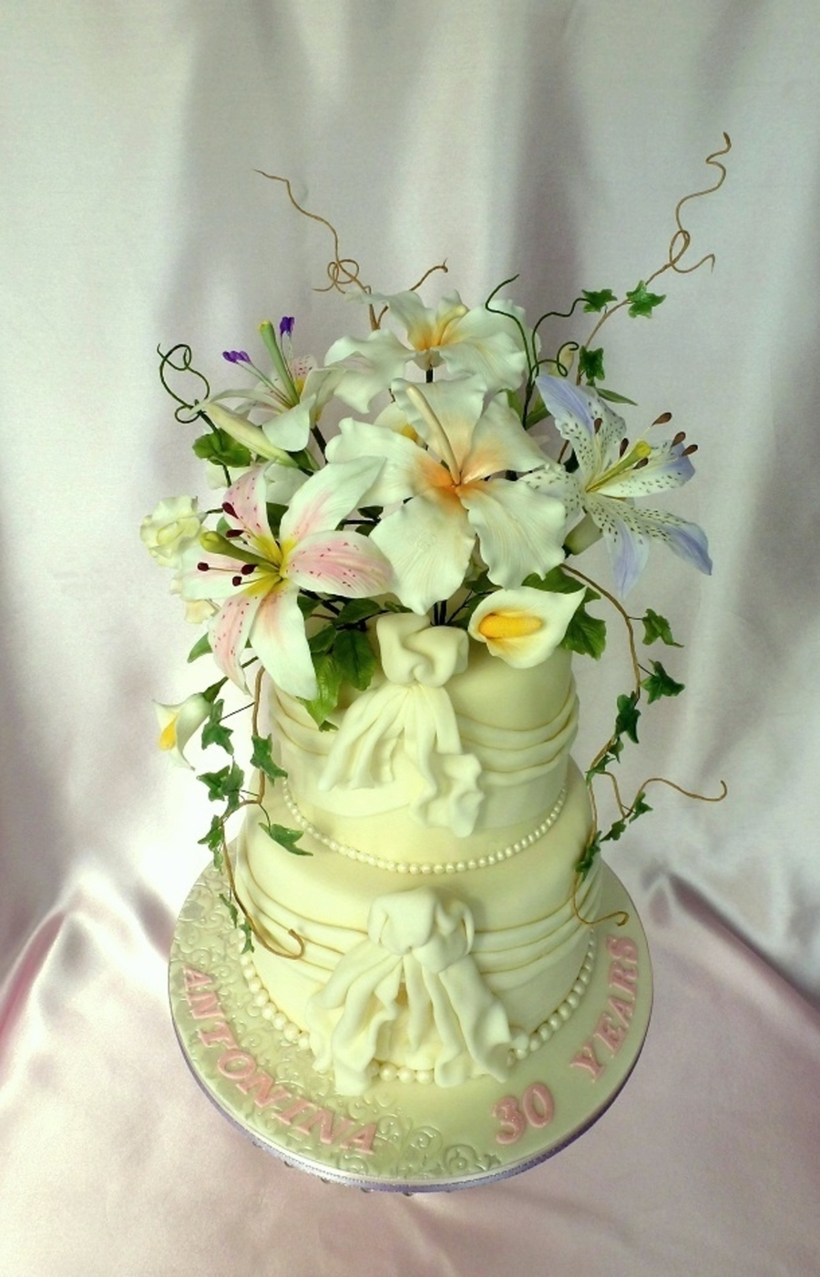 White Wedding Cake With Drapes And Gumpaste Flowers - CakeCentral.com