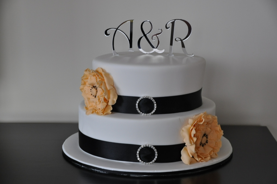 Wedding Cake With Orange Ruffled Flowers on Cake Central