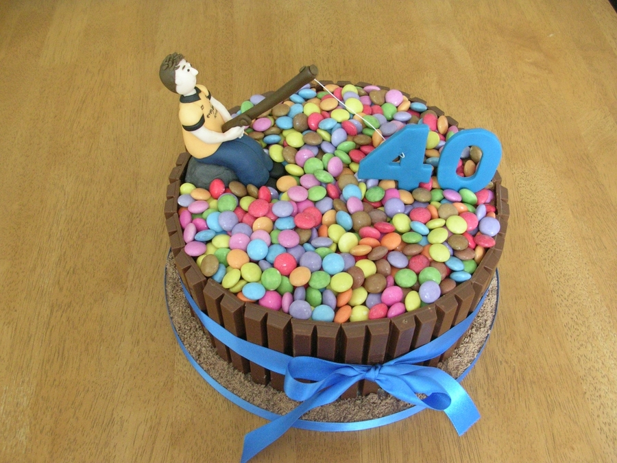 Fishing smarties and kitkat cake for Fishing cake decorations