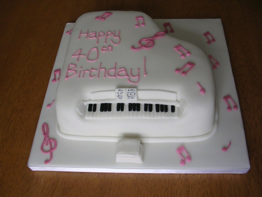 White Piano With Pink Decoration  on Cake Central