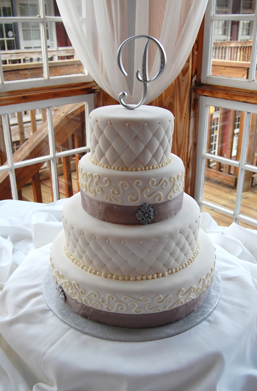 Fondant And Buttercream Wedding Cake Round With Pewter Accents And Ribbon Quilted Texture  on Cake Central