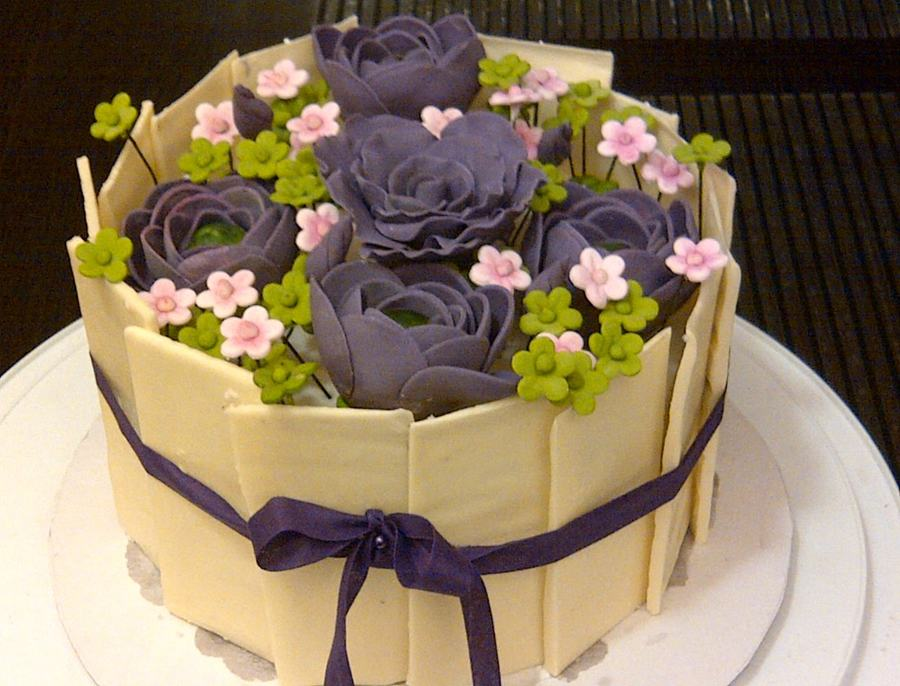 A Chocolate Cake Decorated In Pure Chocolate Panels With ...