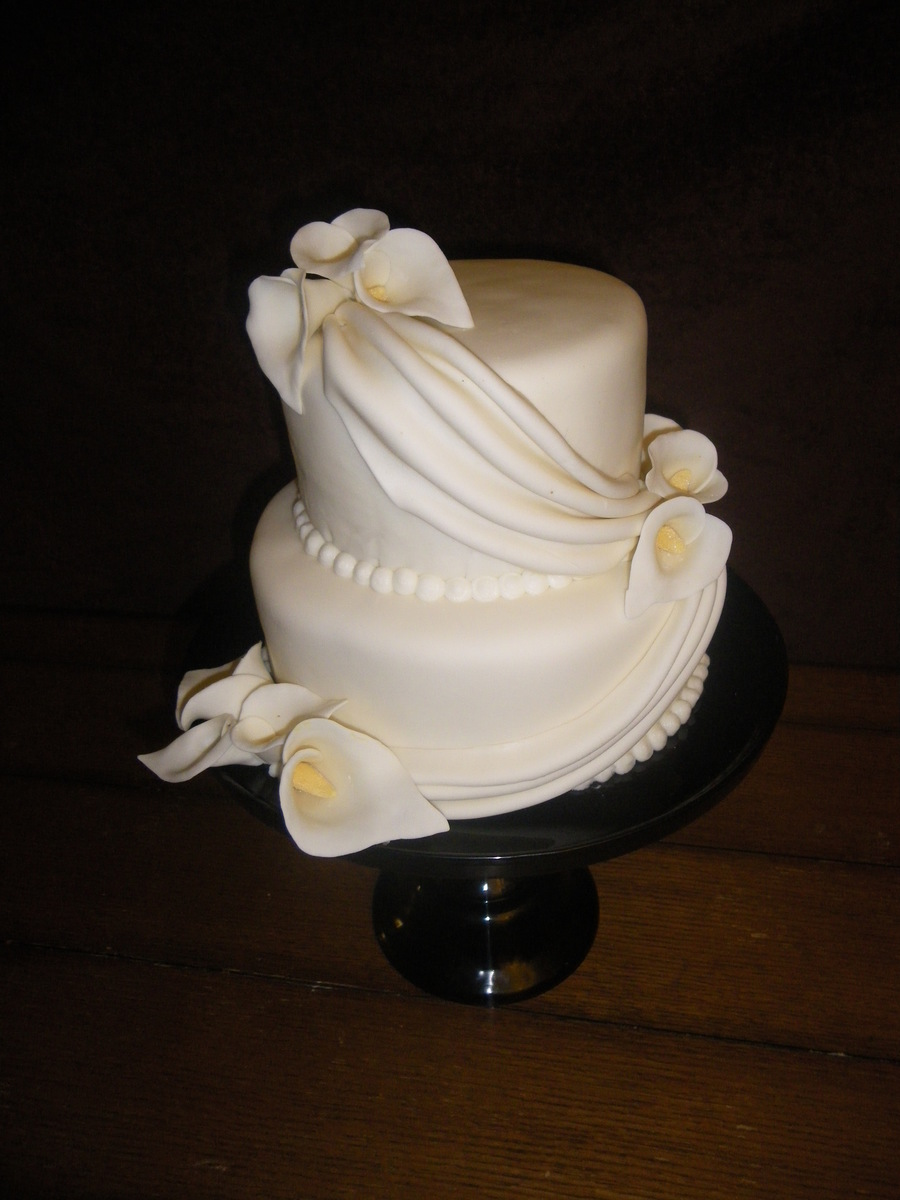Small Wedding Cake With Drapes And Cala Lilies on Cake Central