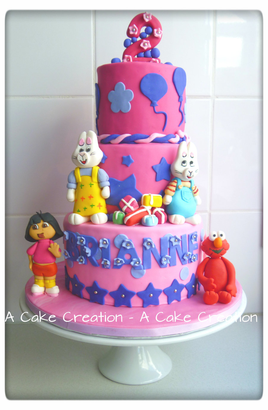 3 Tier Rainbow Cake Buttercream Filled Ganached Iced Pink Fondant Covering All Edible Handmade Characters on Cake Central