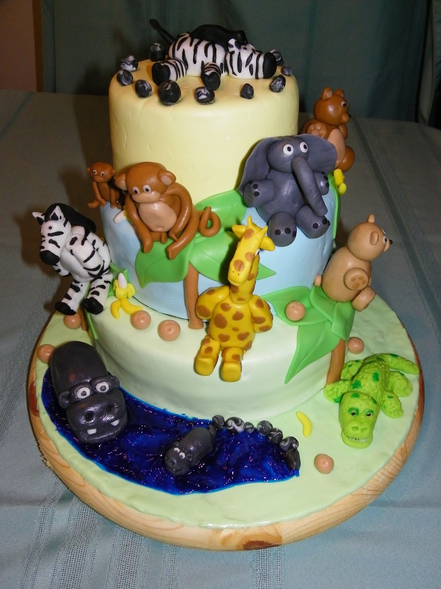 This Cake Was Made For A Baby Shower. Theme Was Jungle. Fondant And Gum  Paste Animals. All Three Tiers Were Marble Cake With Chocolate Pudding  Filling.