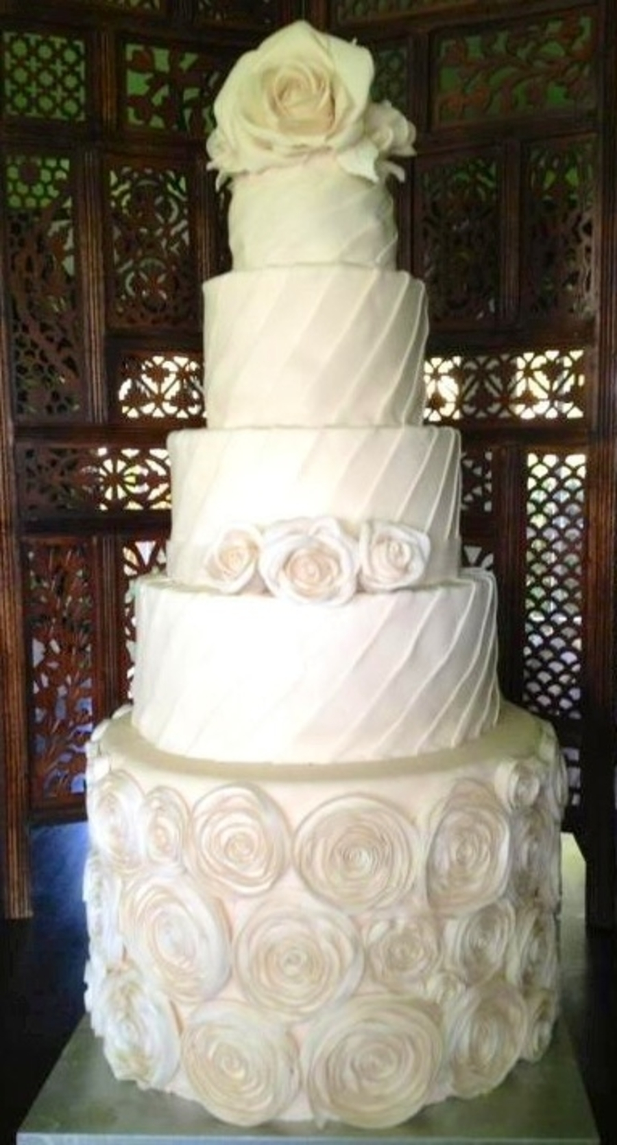 Ivory Roses And Pleats Wedding Cake  on Cake Central