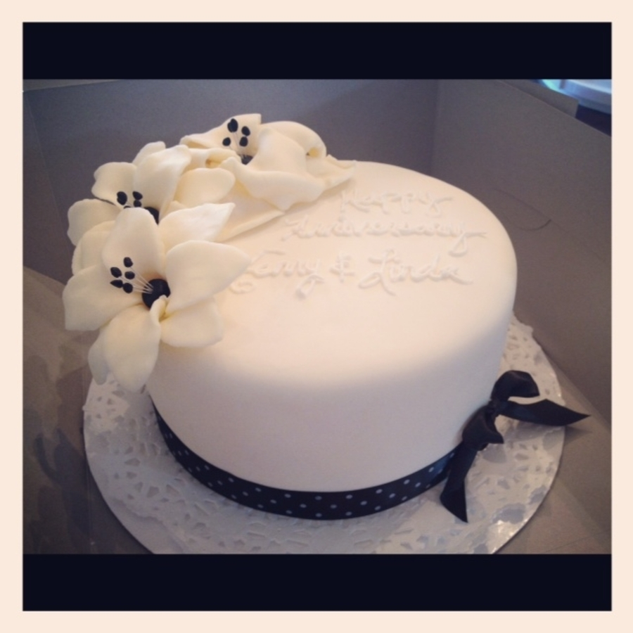 Fondant Cake With White Chocolate Flowers on Cake Central