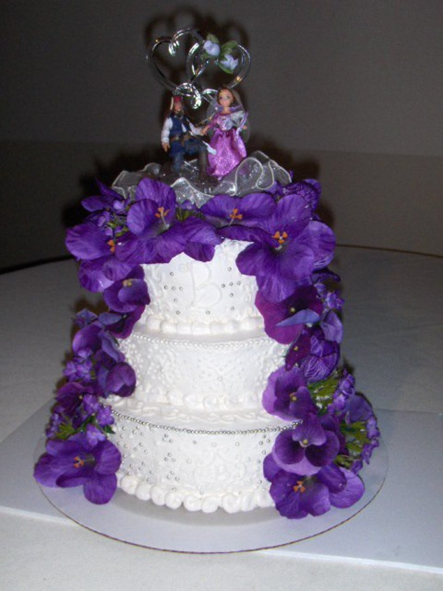 White Wedding Cake With Purple Silk Flowers - CakeCentral.com