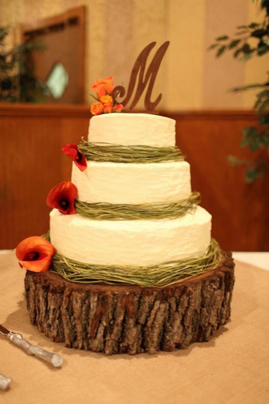 3 Tier Wedding Cake With Green Raffia - CakeCentral.com