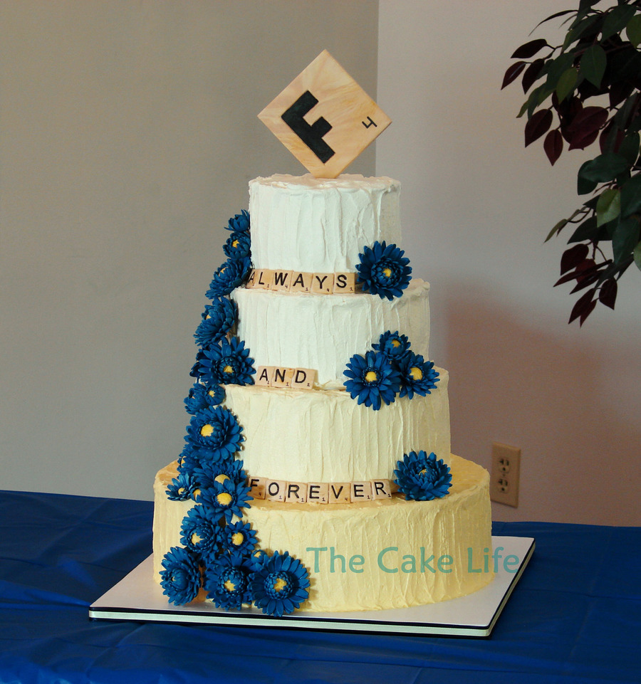 Yellow Ombre Butter Cream Wedding Cake With A Scrabble Theme And Blue Gumpaste Gerber Daisies  on Cake Central