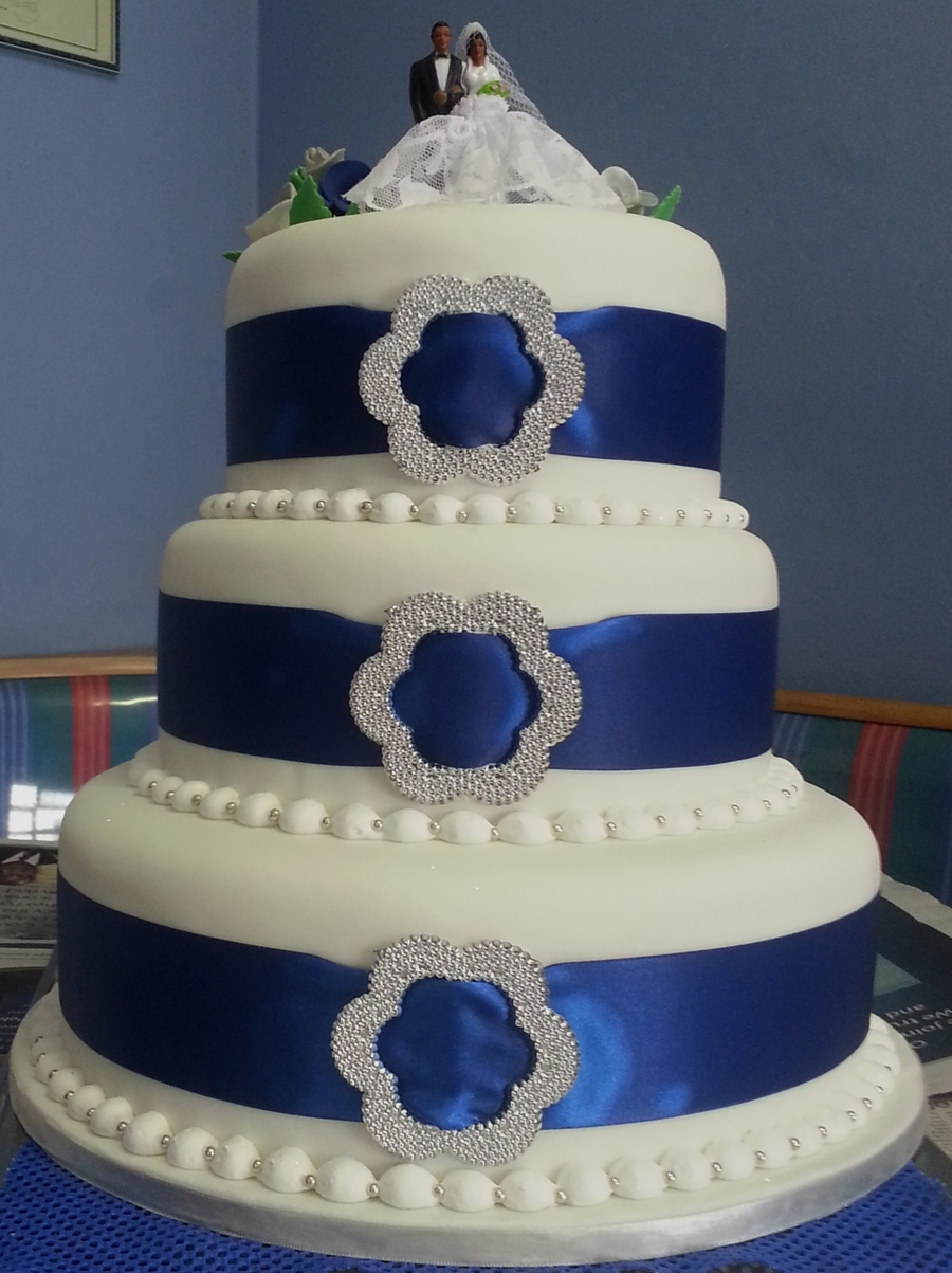 Wedding Cake With Blue Ribbon And Belt Buckle on Cake Central