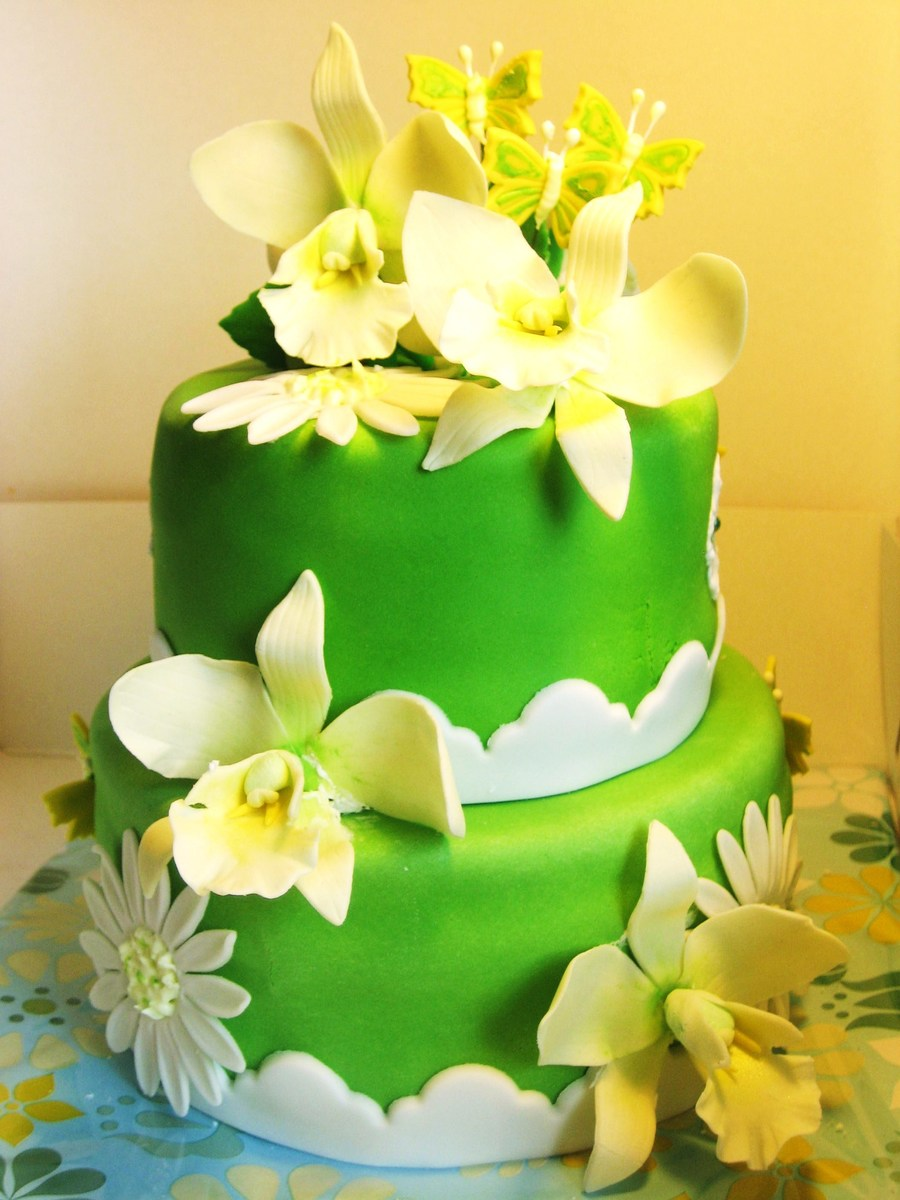 White Orchids On A Green Cake - CakeCentral.com
