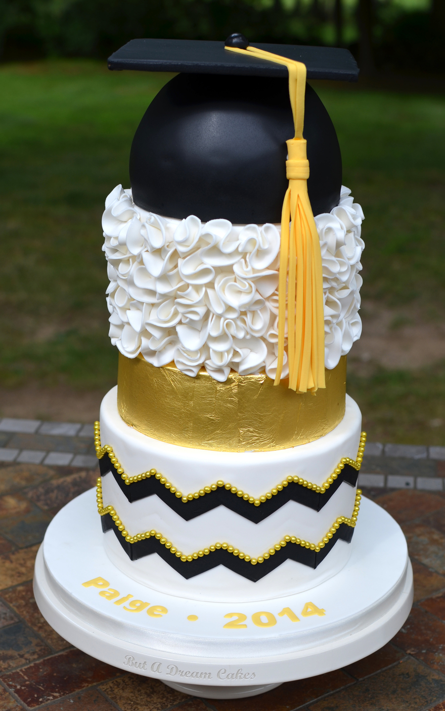 Black And Gold Graduation Cake With Ruffles And Gold Leaf on Cake Central