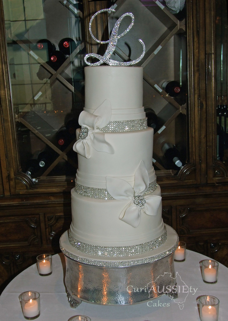Elegant White Bow And Bling Wedding Cake - CakeCentral.com