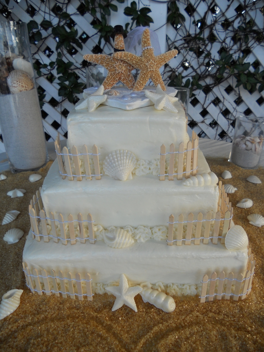 Seashell Wedding Cake With Starfish Bride And Groom Cake