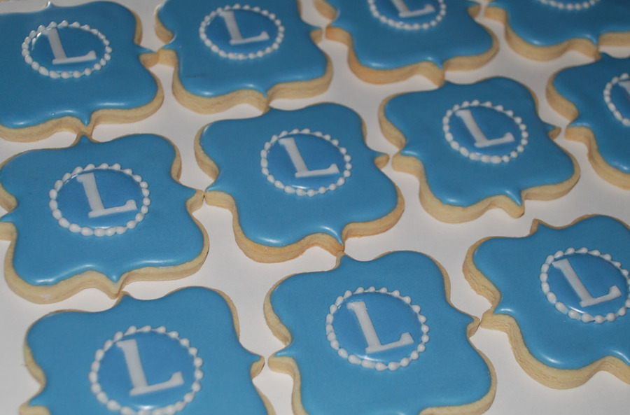 monogram cookies using a fancy square plaque cookie cutter fondant letters and piped border on cake
