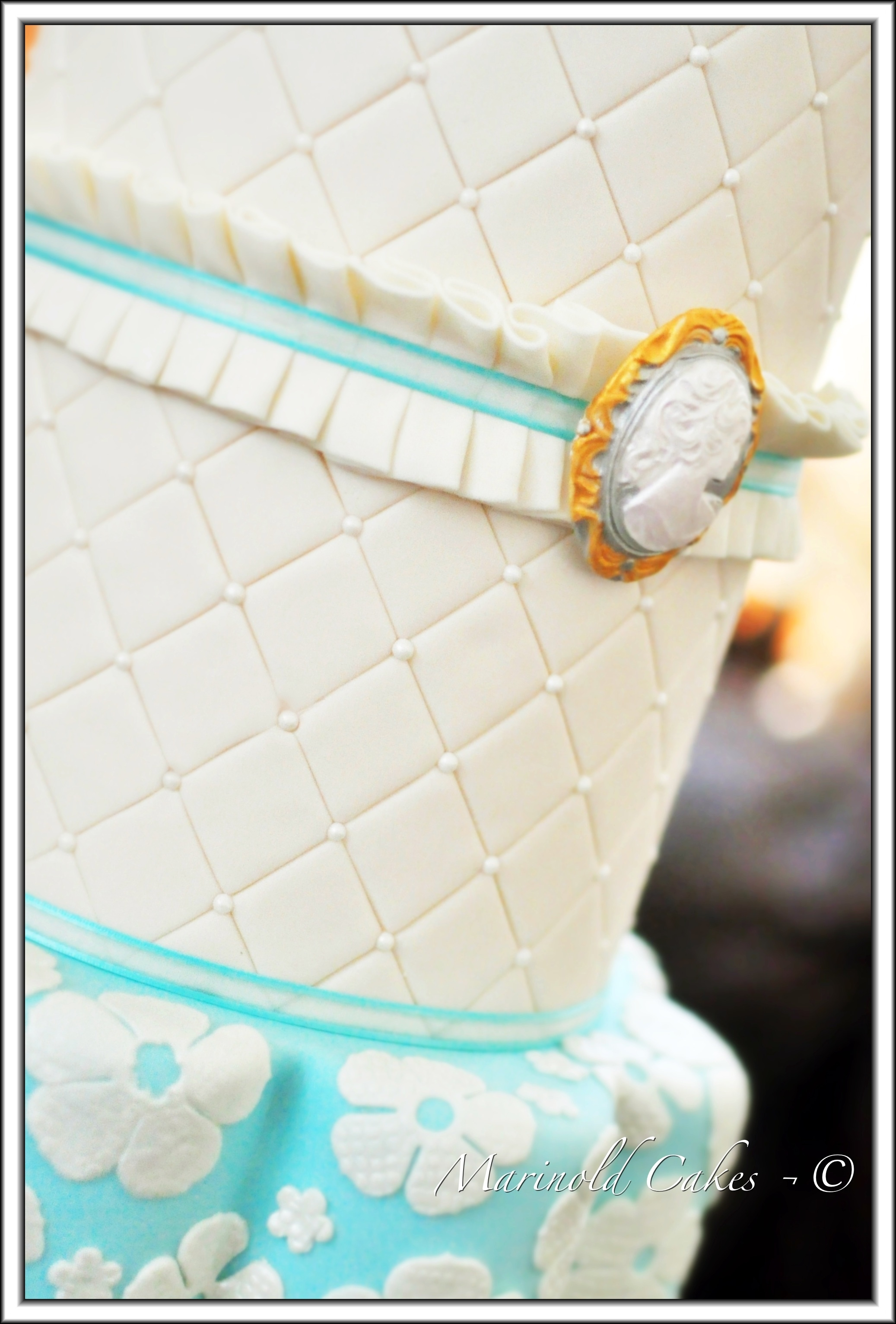 Round Teal Wedding Cake With Cameo - CakeCentral.com