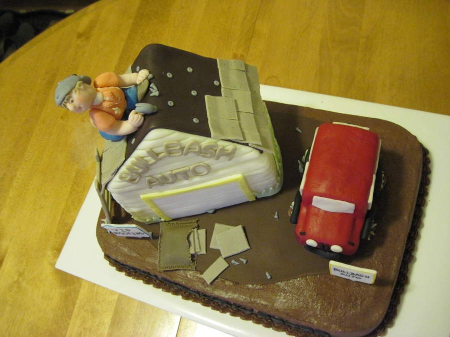 birthday cake for a man who does roofing & car repair. The garage is ...