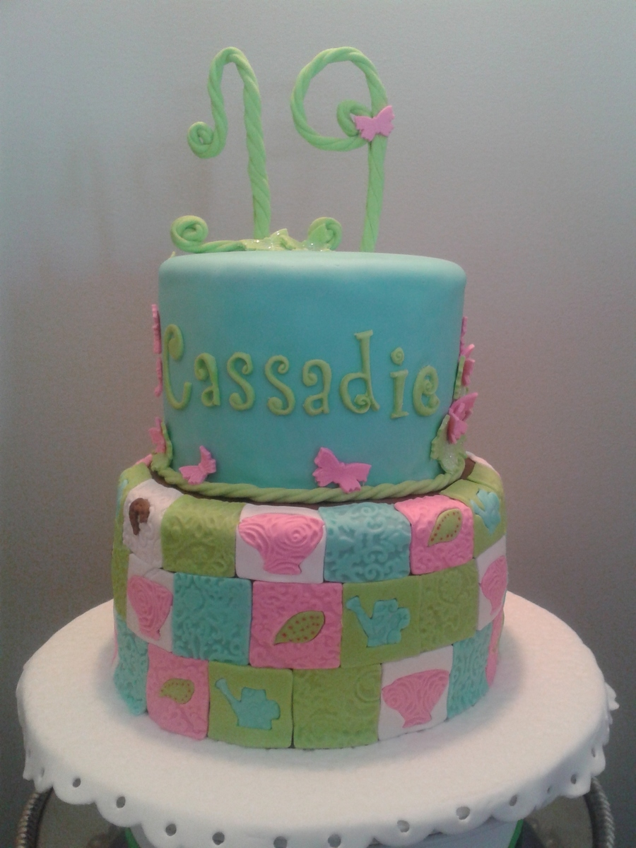 Two Tier Birthday Cake Covered In Fondant Bottom Layer In A Country
