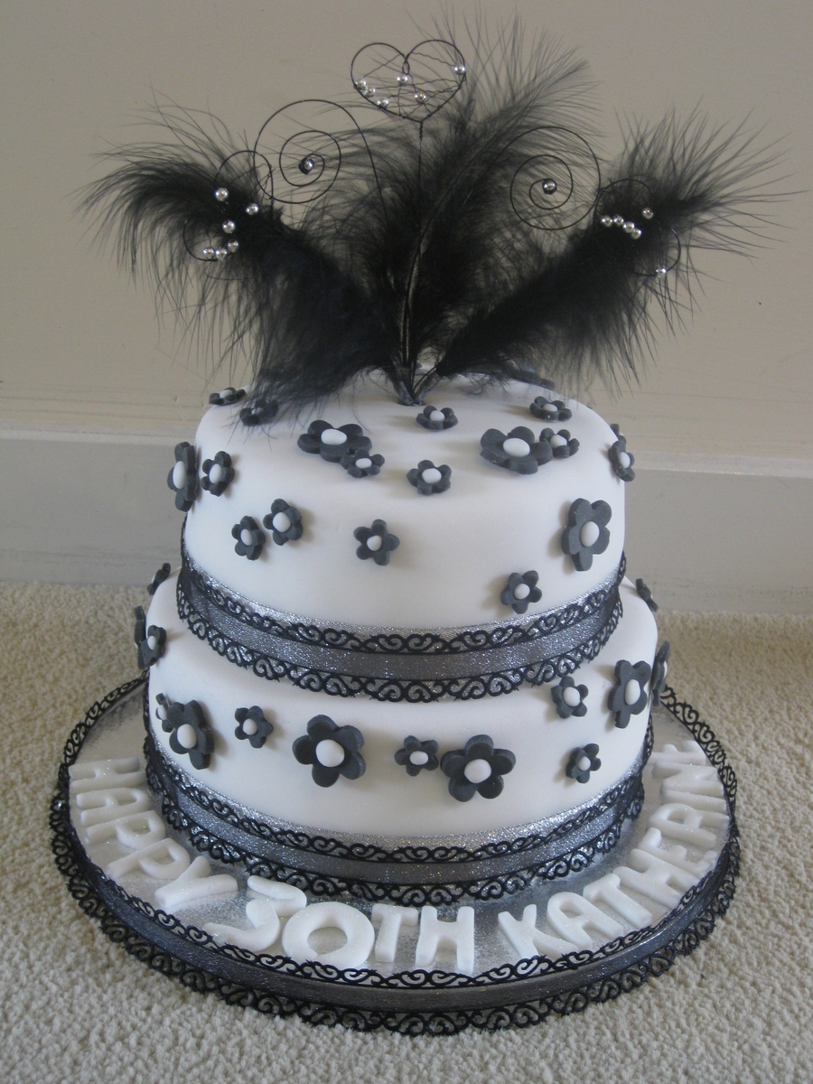 Black White And Silver Two Tiered Cake With Feathers
