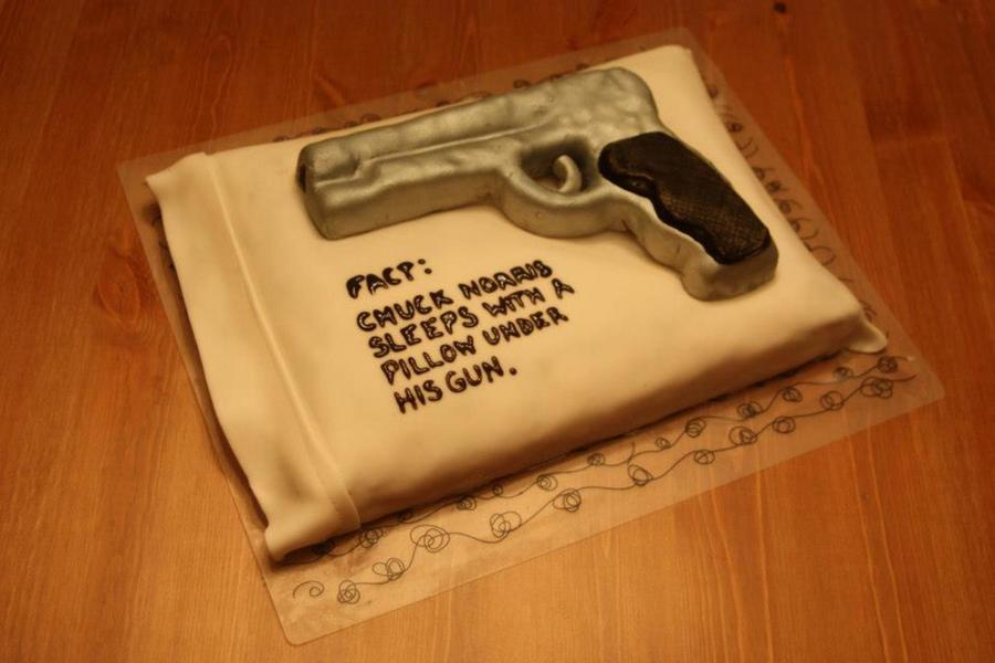 Chuck Norris Sleeps With A Pillow Under His Gun Cakecentral