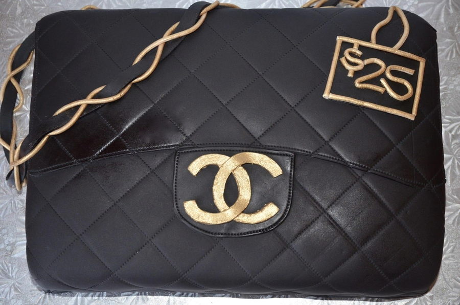 ef10971f2b69 Made this cake for a true diva! So nothing short of an upscale classy  looking Chanel Bag would do. Black Satin Ice fondant made this look almost  like real ...