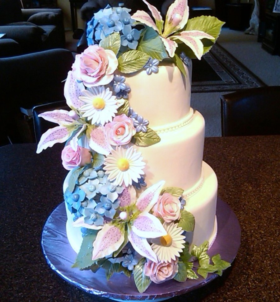 Fondant Covered White Cake With Raspberry Cream Fillingall Flowers Are Made From Gum Paste on Cake Central
