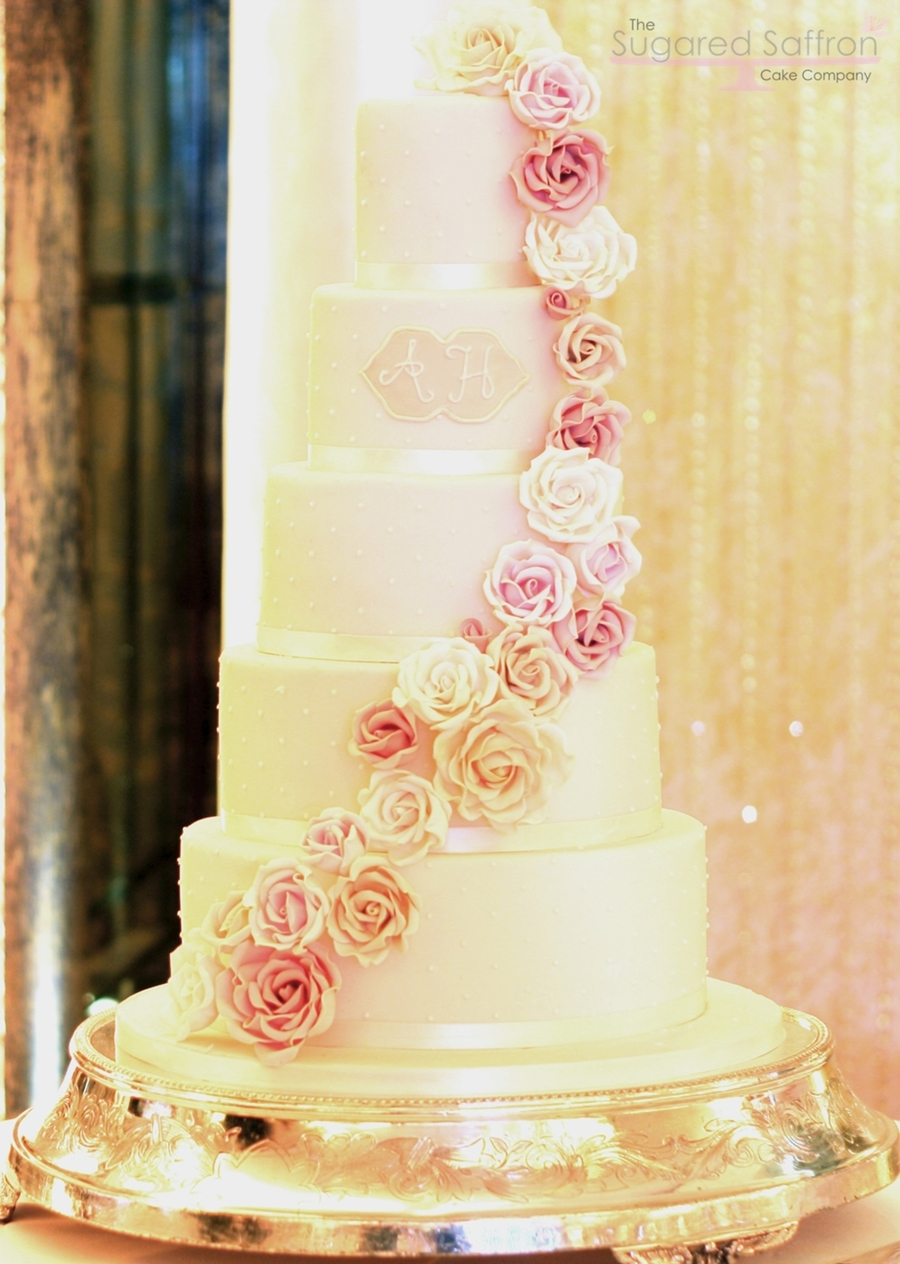 Pearl Piped Rose Cascade  on Cake Central