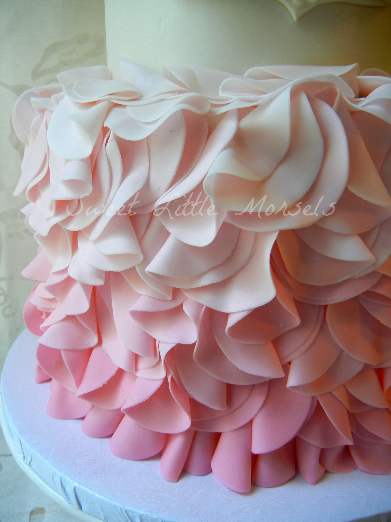 pink ombre ruffle baby shower cake