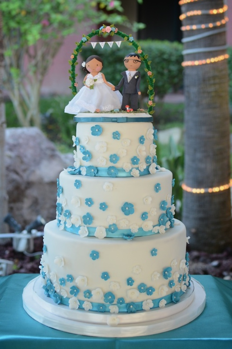 Teal Floral Vanillabean Cake With Mocha Swiss Merengue Filling Flowers And Ribbon Are Fondant on Cake Central